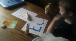 Jacob using the bingo markers to learn his alphabet. He really likes to do this!
